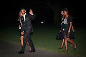 United States President Barack Obama waves to the cameras as he and the First Family walk toward the White House after disembarking Marine One on the South Lawn of the White House in Washington, District of Columbia, U.S., on Sunday, August 31, 2014. The First Family traveled to Westchester County, New York to attend the wedding of senior policy advisor for nutrition policy and Let's Move Executive Director, Sam Kass to MSNBC host Alex Wagner. From left to right: Malia Obama, President Obama, first lady Michelle Obama, and Sasha Obama.<br /> Credit: Pete Marovich / Pool via CNP