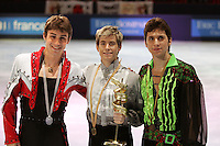 November 19, 2005; Paris, France; (L-R) Winners in mens figure skating are BRIAN JOUBERT of France (silver),  JEFFREY BUTTLE of Canada (gold), GHEORGHE CHIPER of Romania (bronze) at Trophee Eric Bompard, ISU Paris Grand Prix competition.  They are favorites in mens leading up to Torino 2006 Olympics.<br />Mandatory Credit: Tom Theobald/<br />Copyright 2005 Tom Theobald