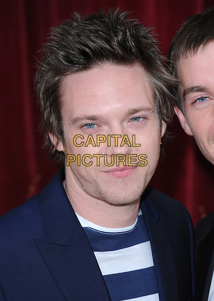 ANDREW MOSS.The British Soap Awards 2010, London Television Centre, London, England..8th May 2010.arrivals headshot portrait black white blue striped stripes stubble facial hair .CAP/BEL.©Tom Belcher/Capital Pictures.