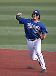 Wildcats's Kody Reynolods makes a play against Colorado Northwestern at Western Nevada College, in Carson City, Nev., on Friday, March 13, 2015. <br /> Photo by Cathleen Allison
