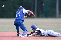 13 July 2010: Luc Piquet of Team France misses the ball as Jordan Pennington dives safely into second base during day 1 of the Open de Rouen, an international tournament with Team France, Team Saint Martin, Team All Star Elite, at Stade Pierre Rolland, in Rouen, France.
