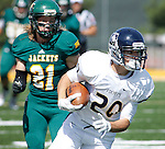 SEPTEMBER 13, 2014 --Daniel Ziegler #20 of South Dakota Mines gets past Black Hills State defender Travis Tweeten #21 during their college football game Saturday at Lyle Hare Stadium in Spearfish, S.D.  (Photo by Dick Carlson/Inertia)