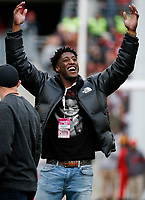 Former Ohio State Buckeyes player Mike Thomas acknowledges the student section during a NCAA college football game between the Ohio State Buckeyes and the Minnesota Golden Gophers on Saturday, October 13, 2018 at Ohio Stadium in Columbus, Ohio. Thomas currently plays for the New Orleans Saints. [Joshua A. Bickel/Dispatch]