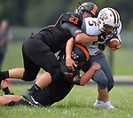 Wesclin players Alex Peterson (top) and Hunter Hancock team up to drag down Dupo running back Lucas Rea. Wesclin defeated Dupo 34-30 on Saturday August 31, 2019 in a game that was stopped Friday night at halftime due to storms. <br /> Tim Vizer/Special to STLhighschoolsports.com