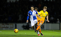 Ryan Sellers of Wycombe Wanderers plays a pass under pressure from Daniel Leadbitter  of Bristol Rovers during the Sky Bet League 2 rearranged match between Bristol Rovers and Wycombe Wanderers at the Memorial Stadium, Bristol, England on 1 December 2015. Photo by Andy Rowland.