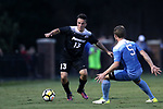 ELON, NC - AUGUST 25: Providence's Brendan Reardon (13) and North Carolina's John Nelson (5). The University of North Carolina Tar Heels hosted the Providence College Friars on August 25, 2017 at Rudd Field in Elon, NC in a Division I college soccer game. UNC won the game 4-2.