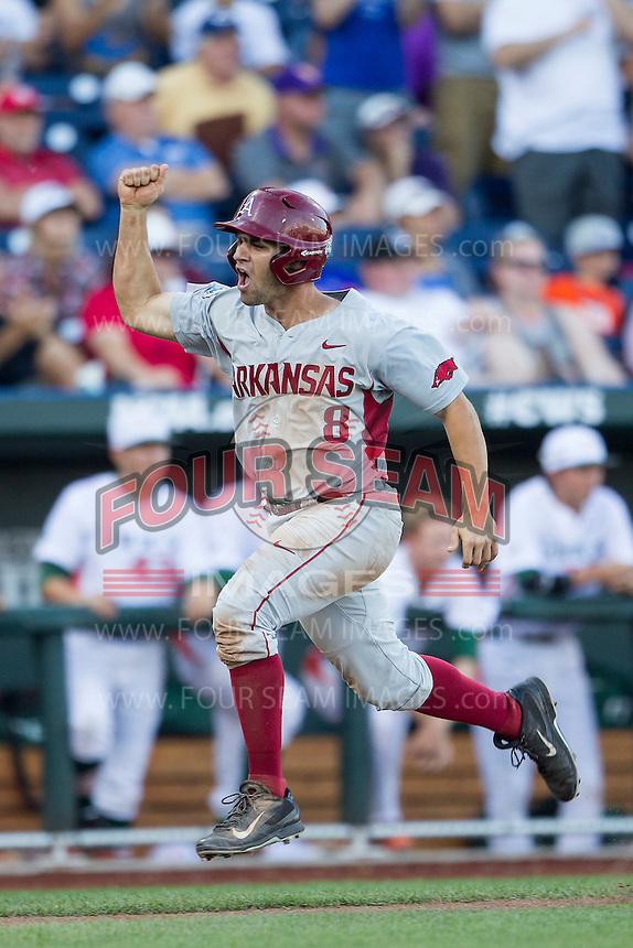 Arkansas Razorbacks outfielder Tyler Spoon (8) scores during the NCAA College baseball World Series against the Miami Hurricanes on June 15, 2015 at TD Ameritrade Park in Omaha, Nebraska. Miami beat Arkansas 4-3. (Andrew Woolley/Four Seam Images)