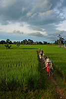 Women on the road from Battambang  to Phnom Penh, Cambodia rural area