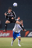 DC United midfielder Devon McTavish (18) leaps to head the ball while defended by Kansas City Wizards forward Yura Movsisyan (17). The Kansas City Wizards defeated DC United 4-2, in the home opener for DC United at RFK Stadium, April 14, 2007.
