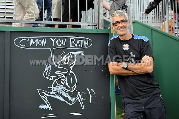 Artist Simon Spilsbury poses with his illustration after the match. Pre-season friendly match, between Bath Rugby and the Scarlets on August 16, 2014 at the Recreation Ground in Bath, England. Photo by: Patrick Khachfe / Onside Images