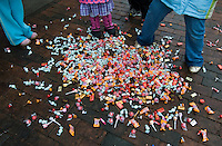 A large bag of candy  is dumped at the feet Christmas parade watchers in downtown Westerville, Ohio, on a wet, rainy afternoon. The bag of candy, offered by a grocery store manager, was intended to feed more children but the weather brought a much smaller crowd than expected with the result being more candy for fewer people. Photo Copyright Gary Gardiner. Not for reproduction without written permission.
