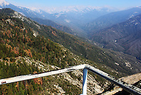 Stock photo: Sierra Nevada mountain peaks and trees seen from an iron railing on the Moro rock of the Sequoia national park , California USA.