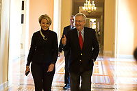 United States Senate Majority Leader Mitch McConnell (Republican of Kentucky) gives a thumbs up as he walks with a staffer from his office to the Senate chamber for a procedural vote to move forward with voting on the Republican proposed tax reform bill at the United States Capitol in Washington, D.C. on Friday, December 1, 2017. Photo Credit: Alex Edelman/CNP/AdMedia