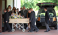 "Pictured: Close family and relatives stand as the coffin of Pat Stewart arrives<br /> Re: The funeral of Pat Stewart at the Cardiff and Glamorgan Memorial Park and Crematorium, Wales, UK. Pat Stewart became famous as ""the girl in the spotty dress"" after an iconic image taken by Bert Hardy in Blackpool in 1951."