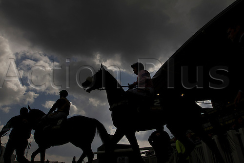 13.04.2012 Aintree, England. The Grand National Festival Ladies Day. Two of the horse emerge onto the track before the start of the first race of the day.