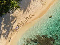 "Aerial view of a family lying next to their message of ""Aloha"" at Mokule'ia Beach near Crozier Drive, Waialua, O'ahu."