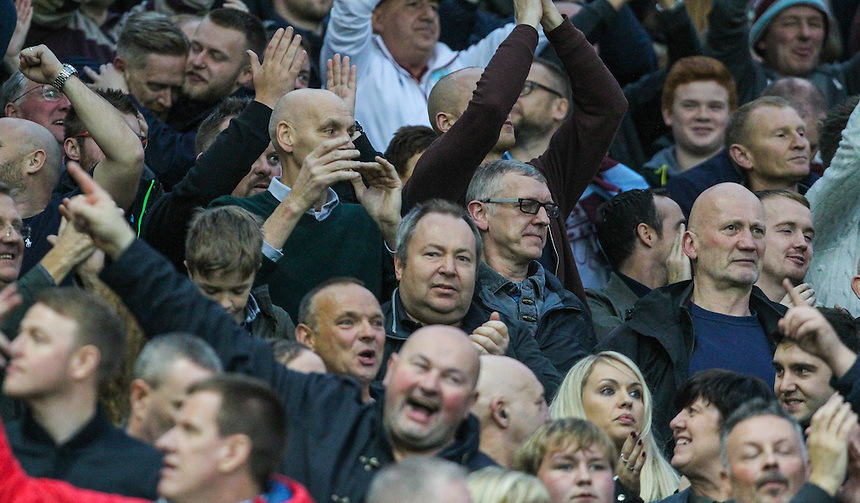 Burnley fans celebrate a 0-0 draw<br /> <br /> Photographer Alex Dodd/CameraSport<br /> <br /> The Premier League - Manchester United v Burnley - Saturday 29th October 2016 - Old Trafford - Manchester<br /> <br /> World Copyright &copy; 2016 CameraSport. All rights reserved. 43 Linden Ave. Countesthorpe. Leicester. England. LE8 5PG - Tel: +44 (0) 116 277 4147 - admin@camerasport.com - www.camerasport.com