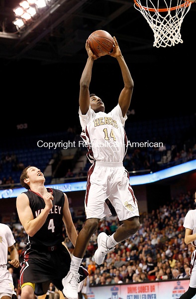 Uncasville, CT- 22 March 2015-032215CM27- Sacred Heart's Raheem Solomon goes to the hoop against Valley Regional's David Bradbury during their Class S state championship game at Mohegan Sun Arena in Uncasville on Sunday. The Hearts won, 71-46.    Christopher Massa Republican-American