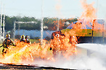 Firefighters attack the flames from a plane fire simulator that engulfs aircraft  and the area around it in fire, during a drill, Saturday, Sept. 29, 2018, in Windsor Locks. WVIT-TV reports the mass casualty exercise involved more than 25 mutual aid agencies at the local, state and federal level and about 100 actors. The Federal Aviation Administration requires the drill every three years. (Jim Michaud / Journal Inquirer)