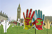 Part of a field of 2500 hands planted in Parliament Square by Hands Up For Peace, an anti-war campaign set up by school students to protest at the invasion of Iraq; 20/3/03