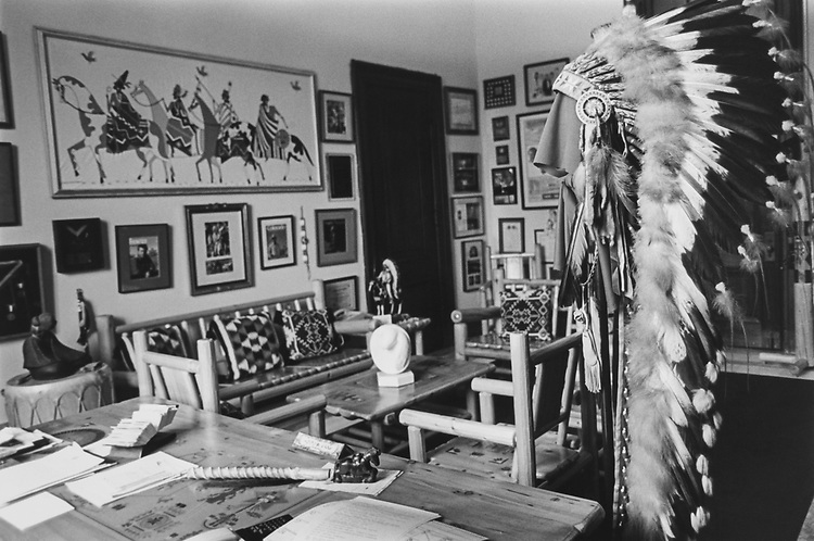Sen. Ben Nighthorse Campbell's office in Russell to be on Capitol Hill tour. Some furniture designed was by Senator or his son and many pieces were given to him as gift. His own headdress is in the foreground. April 1994. (Photo by Maureen Keating/CQ Roll Call via Getty Images)