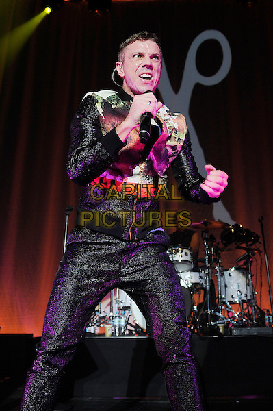 Jake Shears.Scissor Sisters performing live in concert, Camden Roundhouse, London, England. .23rd October 2012.on stage gig performance performing music half 3/4 singing length black trousers orange green print jacket dancing.CAP/MAR.© Martin Harris/Capital Pictures.