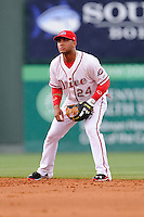 Second baseman Yoan Moncada (24) of the Greenville Drive tracks a ground ball during a game against the Lexington Legends on Monday, May 18, 2015, at Fluor Field at the West End in Greenville, South Carolina. Moncada, a 19-year-old prospect from Cuba, made his professional debut tonight in the Red Sox organization. (Tom Priddy/Four Seam Images)