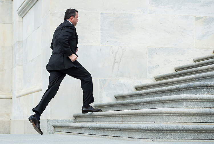 UNITED STATES - MARCH 21: Rep. Michael Grimm, R-NY.,  runs up the House steps for the last votes before the Easter recess on Thursday, March 21, 2013. (Photo By Bill Clark/CQ Roll Call)