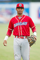 Angelo Mora (18) of the Lakewood BlueClaws warms up in the outfield prior to the game against the Kannapolis Intimidators at CMC-Northeast Stadium on August 13, 2013 in Kannapolis, North Carolina.  The Intimidators defeated the BlueClaws 12-8.  (Brian Westerholt/Four Seam Images)