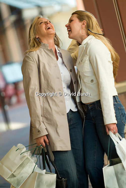 Mother and daughter, shopping and laughing