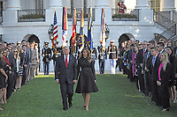 United States President Donald J. Trump and first lady Melania Trump walk out of the White House to lead a moment of silence in remembrance of those lost on September 11, 2001 on the South Lawn of the White House in Washington, DC on Monday, September 11, 2017.<br /> CAP/MPI/CNP/RS<br /> &copy;RS/CNP/MPI/Capital Pictures