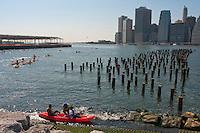 Brooklyn, NY -  28 August 2010 - Kayackers come ashore in Brooklyn Bridge Park
