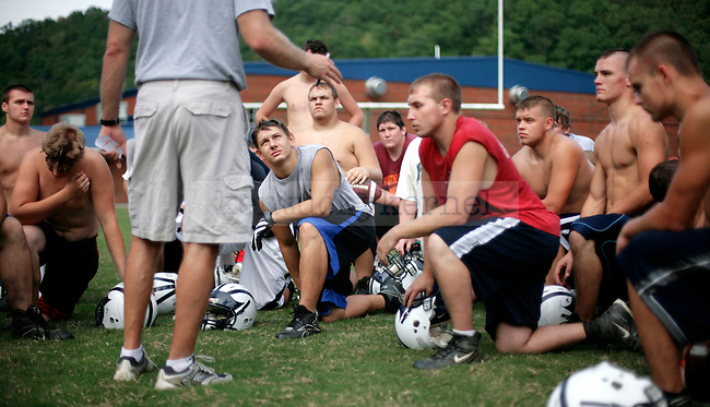 Members of the 2009 Knott County Central High School football team listen to the coach speak after practice on Thursday, Sept. 17, 2009. The team which played the following night, is 1-3 so far this season.