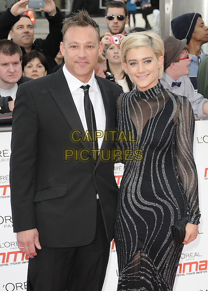 TOBY ANSTIS & KATIE WAISSEL .National Movie Awards 2011 at Wembley Arena, London, England, UK,.May 11th 2011..half length black high neck sleeve dress sheer silver see thru through suit tie .CAP/CAN.©Can Nguyen/Capital Pictures.