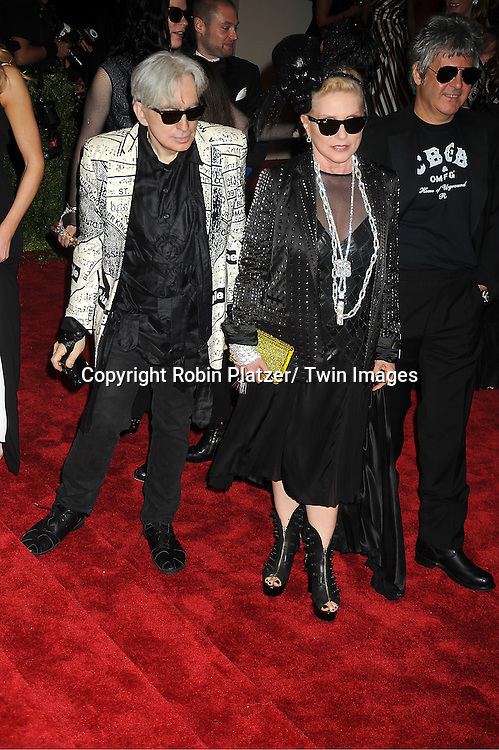 Chris Stein and Deborah Harry and Clem Burke attend  the Metropolitan Museum of Art Costume Institute Beneift celebrating the opening of  PUNK: Chaos .to Couture on May 6, 2013 in New York City.