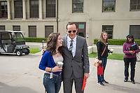 A student with actor Clark Gregg, who plays Agent Phil Coulson in the Marvel cinematic universe. Production of Agents of S.H.I.E.L.D. in the Academic Quad at Occidental College, Los Angeles, Calif., Oct. 28, 2013. (Photo by Marc Campos, Occidental College Photographer)