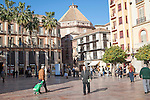 People walking across Plaza Constitucion, Malaga, Spain