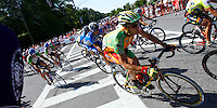 Jesse Anthony (142), of KodakGallery.com-Sierra Nevada, and the rest of the peloton take a corner during the Stage 6 finishing circuit of the Ford Tour de Georgia. Juan Jos&eacute; Haedo of Toyota-United Pro won the 118.2-mile (190.2-km) stage from Cumming to Alpharetta. Floyd Landis of Phonak Hearing Systems won the entire Tour de Georgia.<br />