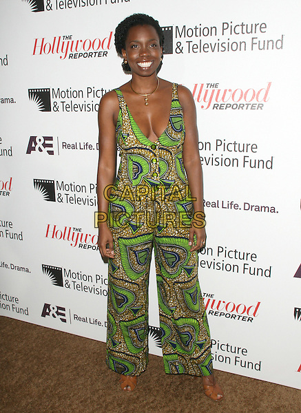 Adepero Oduye.'Reel Stories, Real Lives' Celebration of the Motion Picture & Television Fund' 90 Years of Service to the Community and Recognizes The Hollywood Reporter's Next Generation Class of 2011 held at Milk Studios in Los Angeles, California, USA..November 5th, 2011 .full length green print playsuit low cut neckline cleavage                                                                                .CAP/RKE/DVS.©DVS/RockinExposures/Capital Pictures.