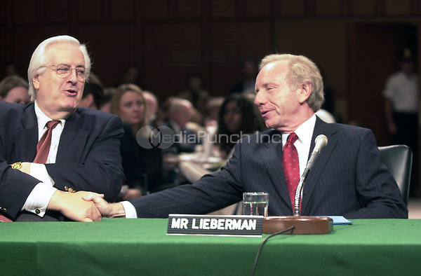 United States Senator Joseph Lieberman (Democrat of Connecticut), the 2000 Democratic Party nominee for Vice President of the United States, right, shakes hands with US House Judiciary Committee Chairman Henry Hyde (Republican of Illinois), left, before they testified before the U.S. Senate Committee on Commerce, Science, and Transportation hearing on marketing Violence to Children in Washington, DC on September 13, 2000.<br /> Credit: Ron Sachs / CNP/MediaPunch