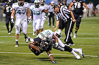 20 December 2011:  FIU wide receiver T.Y. Hilton (4) stretches out in an effort to reach the end zone while being tackled by Marshall linebacker Devin Arrington (25) in the first quarter as the Marshall University Thundering Herd defeated the FIU Golden Panthers, 20-10, to win the Beef 'O'Brady's St. Petersburg Bowl at Tropicana Field in St. Petersburg, Florida.