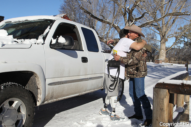 LaVoy Finicum, right, hugs James Stanton, from Ft. Sumner, NM, at the Malheur National Wildlife Reserve on January 15, 2016 in Burns, Oregon.  Stanton drove all the way from Newmexico with his truck loaded with supplies to give to the activists.     Photo by Jim Bryant/UPI