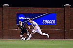 GREENSBORO, NC - DECEMBER 02: Colby Thomas #5 of Messiah College dribbles the ball past Kyle Robson #4 of North Park University during the Division III Men's Soccer Championship held at UNC Greensboro Soccer Stadium on December 2, 2017 in Greensboro, North Carolina. Messiah College defeated North Park University 2-1 to win the national title. (Photo by Grant Halverson/NCAA Photos via Getty Images)