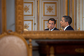 Caen, France - June 6, 2009 -- United States President Barack Obama and President Nicolas Sarkozy of France are reflected in a mirror during a bilateral meeting in Caen, France, Saturday, June 6, 2009..Mandatory Credit: Pete Souza - White House via CNP