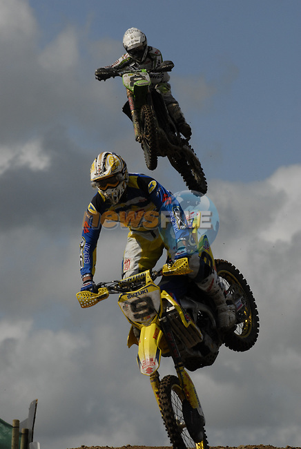 Eventual winner Ken De Dycker (BEL) leads 2nd place Tanel Leok (EST) over the table top jump in the MX1 Grand Prix Race1 during the Motocross Grand Prix at Fairyhouse Race Course, Co.Meath, Ireland, 31st August 2008.(Photo Eoin Clarke/Newsfile)