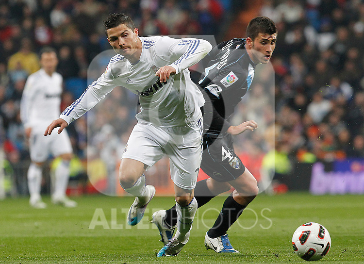 Real Madrid's Cristiano Ronaldo (l) and Malaga's Manu Torres during La Liga match.March 3,2011. (ALTERPHOTOS/Acero)
