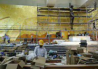 African immigrant working inside the new church Santissima Trindade complex of the Satuary of Fatima in 25 September 2007.