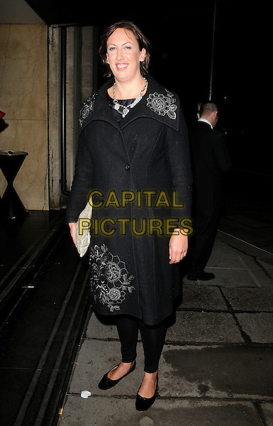 MIRANDA HART .At the Broadcast Awards, Grosvenor House hotel, Park Lane, London, England, UK, 2nd February 2011..full length black coat leggings ballet flats shoes clutch bag embroidered .CAP/CAN.©Can Nguyen/Capital Pictures.