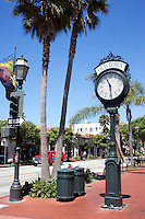 Wrought-iron street clock on the terracotta-tiled sidewalks of the old town area of Santa Barbara in California