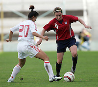 MAR 9, 2006: Faro, Portugal:  USWNT forward (9) Heather O'Reilly tries to dribble past China defender (20) Huana Liu at the Algarve Cup in Faro, Portugal. Mandatory Credit: Photo By Brad Smith-International Sports Images. (c) Copyright 2006 Brad Smith